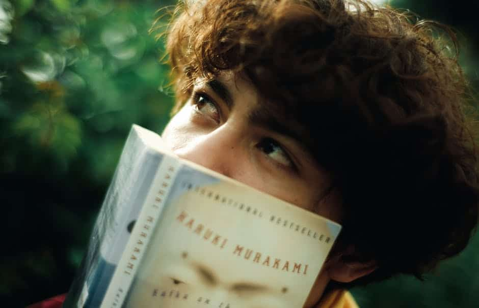 A close up of a person holding a book